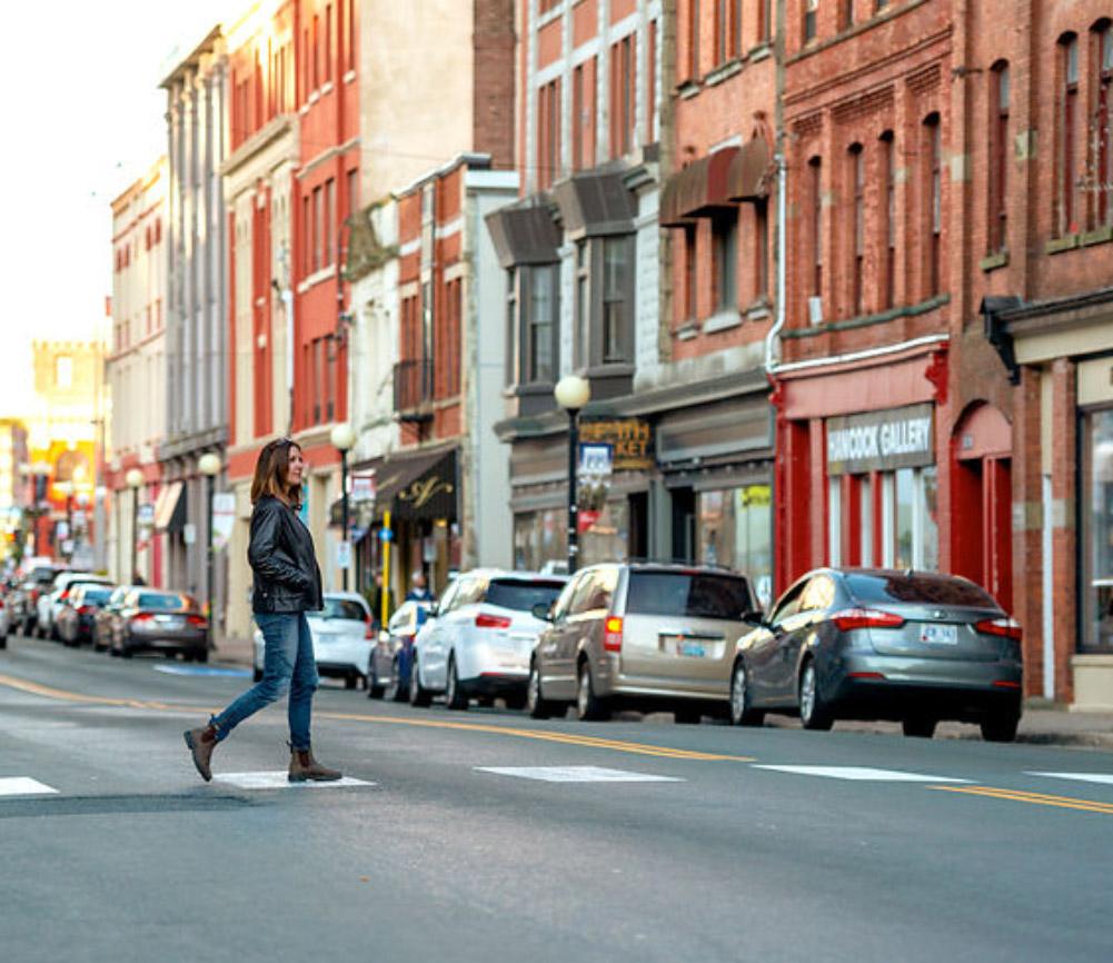 Woman enjoying a casual stroll at a pedestrian walkway on Water Street in St. John's
