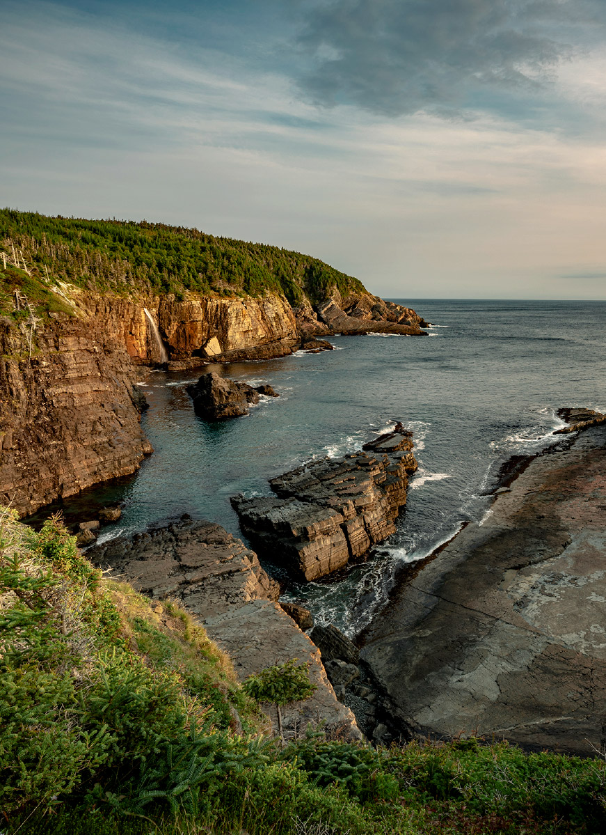 Rugged, rocky cliffs and a beautiful expanse of water at Stiles Cover Waterfall, Newfoundland and Labrador